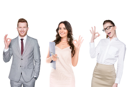portrait of young smiling people showing ok sign isolated on white
