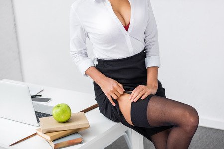 young teacher in stockings