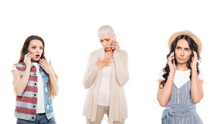 portrait of shocked multigeneration women talking on smartphones isolated on white Stock Photo