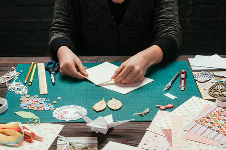 cropped image of designer cutting empty sheet of paper Stock fotó