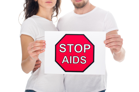 cropped shot of couple with stop aids placard isolated on white Stock Photo
