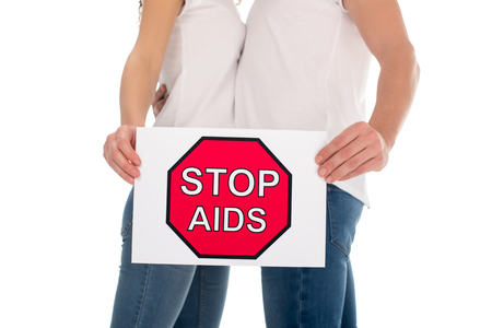 cropped shot of couple with stop aids banner isolated on white