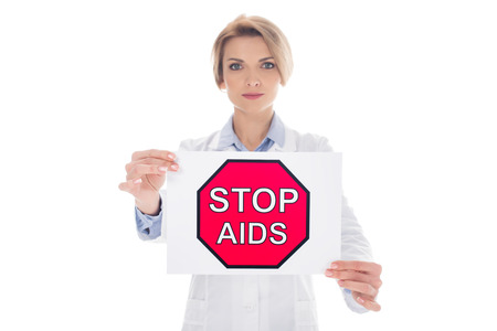female doctor with stop aids placard isolated on white