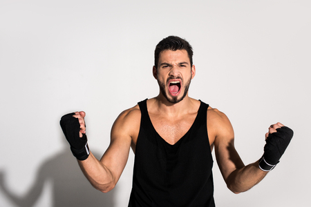 angry shouting fighter with bandaged hands Stock Photo