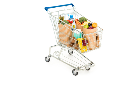 grocery bags in shopping trolley isolated on white Standard-Bild