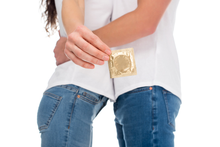 cropped shot of couple with packed condom isolated on white