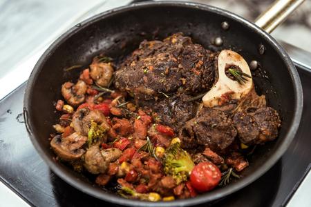 vegetables stew and meat in frying pan Reklamní fotografie