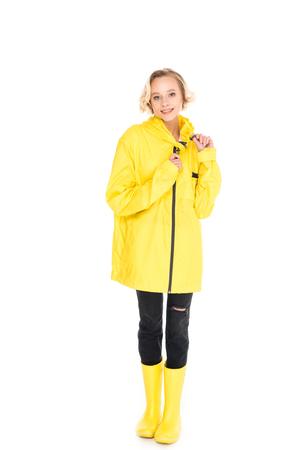 young woman in stylish yellow raincoat and rain boots isolated on white 版權商用圖片 - 114471528