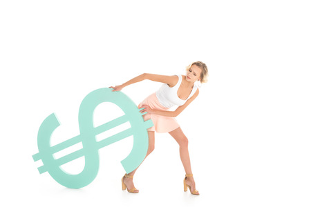 beautiful woman pulling dollar sign on back and looking at camera isolated on white Standard-Bild - 114471825