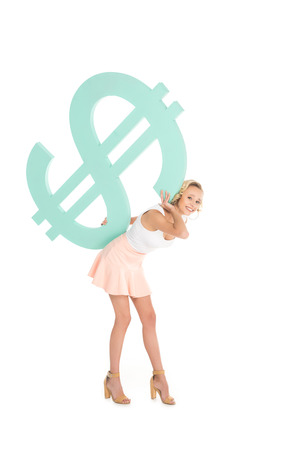 smiling beautiful woman holding dollar sign on back and looking at camera isolated on white Standard-Bild - 114471827