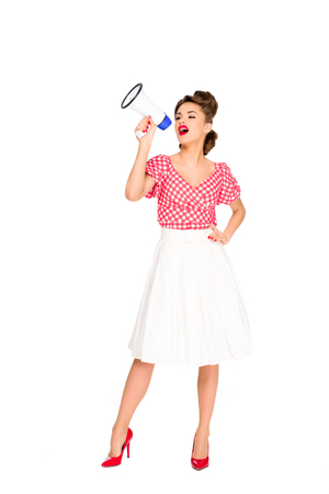 fashionable young woman in pin up style clothing with loudspeaker isolated on white