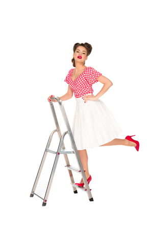 pin up woman standing on ladder isolated on white Stok Fotoğraf