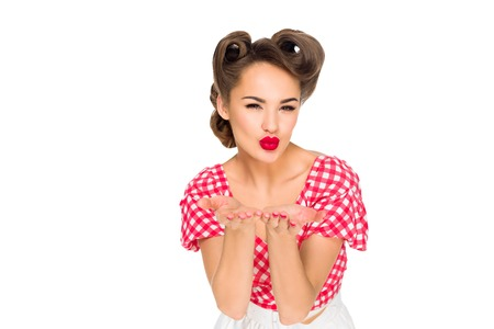 portrait of attractive woman in retro style clothing blowing kiss isolated on white Banco de Imagens