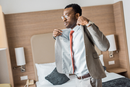 handsome african american businessman wearing gray jacket Stock Photo