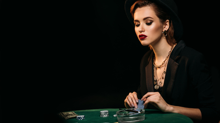 attractive girl looking down at poker table in casino Imagens
