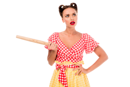 Young pretty pin up girl holding rolling pin isolated on white