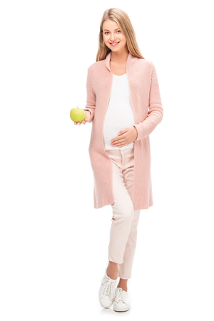 beautiful pregnant woman holding green apple isolated on white Stock Photo