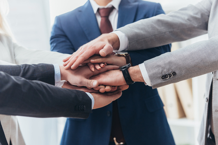 partial view of professional business people stacking hands together Foto de archivo - 116292898