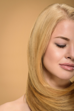 Partial view of sensual blonde girl posing with eyes closed
