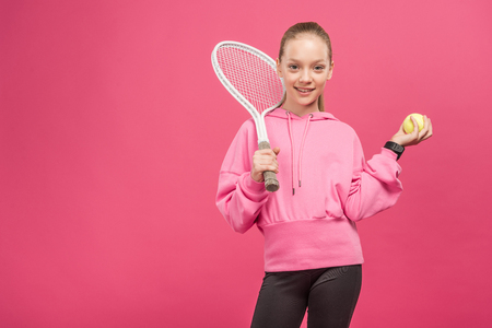adorable little tennis player with racket and ball, isolated on pink