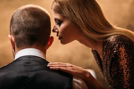 attractive girl whispering something to croupier at casino Stock Photo