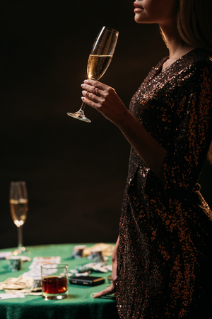 cropped image of girl drinking champagne at casino Stok Fotoğraf - 116318524