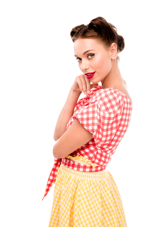 Stylish pin up girl holding hand on cheek and looking at camera isolated on white 스톡 콘텐츠