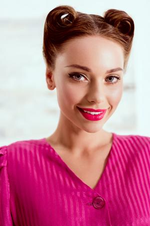 Portrait of beautiful smiling pin up girl in crimson dress