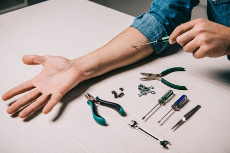 cropped view of man repairing hand with metallic tools