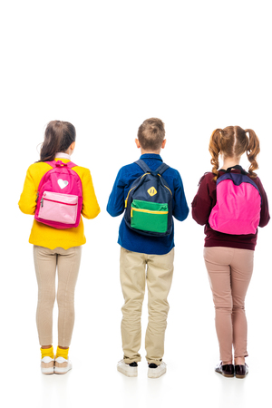 back view of schoolchildren with multicolored backpacks isolated on white 写真素材