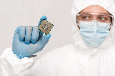 selective focus of microchip in hand of scientist in googles isolated on grey Stok Fotoğraf