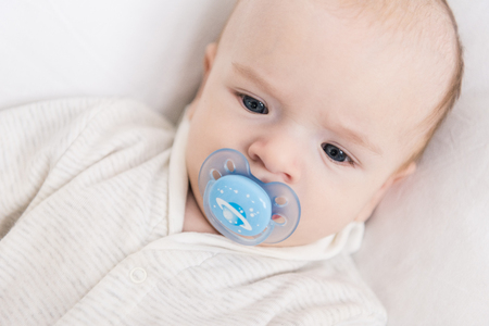 portrait of little baby with pacifier