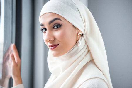 portrait of beautiful young muslim woman smiling at camera