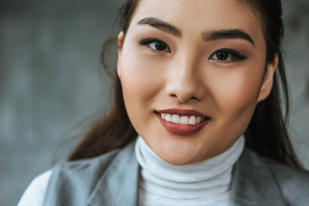 close-up portrait of beautiful young asian woman smiling at camera Stock Photo