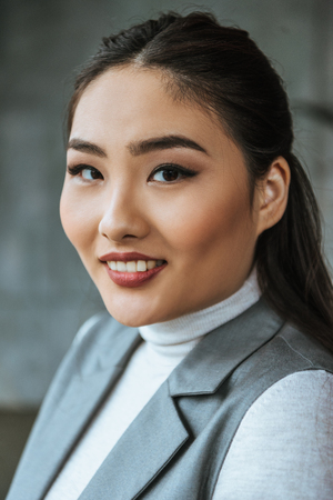 portrait of beautiful young kazakh woman smiling at camera Stock Photo