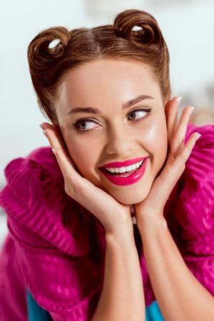 portrait of beautiful pin up girl in crimson dress