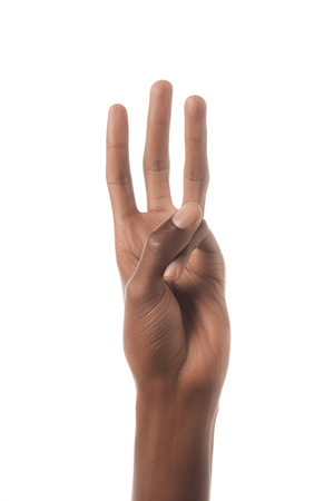 cropped view of african american man showing letter W in deaf and dumb language isolated on white Stock Photo - 116392277