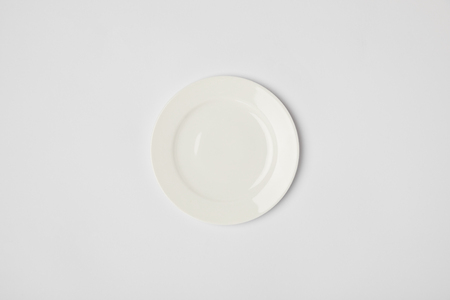 top view of porcelain plate on grey background