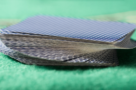 selective focus of unfolded playing cards in deck on green poker table Stock fotó