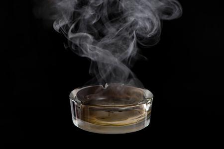 Studio shot of glass ashtray on black Stock Photo