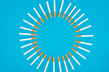Top view of cigarettes isolated on blue