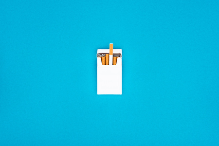 Top view of white cigarette pack isolated on blue