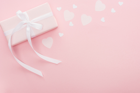 top view of gift box and paper hearts isolated on pink with copy space Banco de Imagens