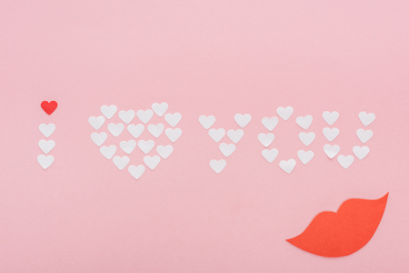 top view of i love you lettering made of paper hearts isolated on pink, st valentines day concept Stock Photo