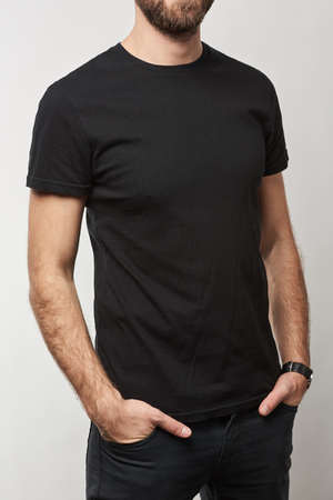 cropped view of man in basic black t-shirt with copy space isolated on white Banco de Imagens - 116495158