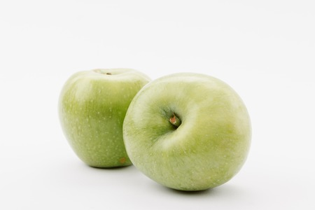 tasty large green apples on white background