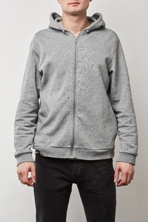 cropped view of man in grey hoodie with copy space isolated on white