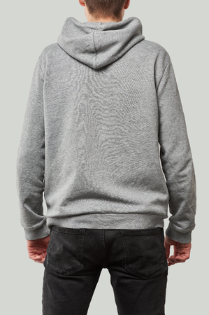 back view of man in grey hoodie with copy space isolated on white
