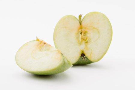 cut ripe green apple on white background Imagens
