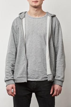 cropped view of man in casual grey hoodie with copy space isolated on white